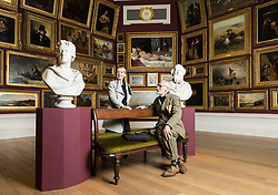 """The National Galleries of Scotland (NGS) and the Royal Scottish Academy (RSA) have collaborated to organise a major new exhibition, which opens in Edinburgh on 4 November 2017 and runs to 7 January 2018. """"Ages of Wonder: Scotland's Art 1540 to Now"""" will be the largest exhibition of the RSA's hugely significant collection ever mounted and the first to occupy the entire RSA building.<br /> <br /> The artworks on show will cover a period of nearly five centuries, from 1540 until the present day, from the The Adoration of the Kings by Jacopo Bassano (c.1510–1592) right through to Callum Innes's Exposed Painting Lamp Black, submitted as the artist's Diploma Work in 2015 after his election as an Academician, and a number of new commissions. Among the exhibition's highlights will be a spectacular recreation of a Victorian gallery hang, which in RSA Gallery 3 will see over 90 works hung as they would have in the 19th Century, from dado rail to ceiling. <br /> <br /> Pictured: John Byrne and Alison Watt in RSA Gallery 3"""