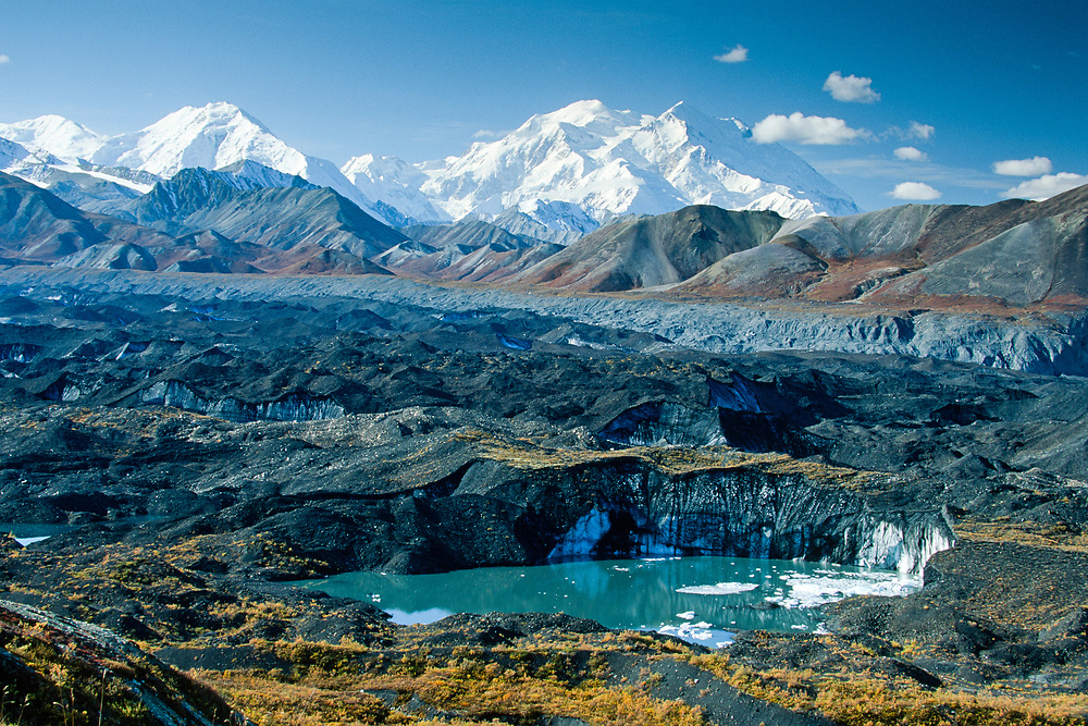 Mt. McKinley rises above an iceberg filled meltpond on the surface of Muldrow Glacier. Denali National Park. Alaska.