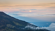 Moonrise over Costa Rica's Caribbean coast. View from Irazu Volcano at 330 meters of altitude.