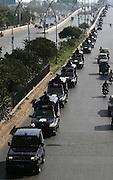 A convoy of Pakistani paramilitary patrols a street in Karachi, Pakistan.