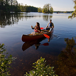 A couple canoeing on Pawtuckaway Lake in New Hampshire's Pawtuckaway State Park.