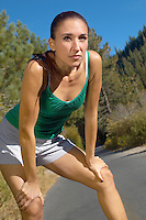 Woman Taking a Break During Her Jog
