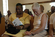 "Rita Schwerner Bender,right,widow  of murdered civil rights worker Michael ""Micky"" Schwerner, bows her head during the  emotioanl  memorial service at the Mt. Zion U.M. Church in Philadelphia Ms. Sunday June 19,2005. Sitting next to her is Barbara Chaney Dailey, James Chaney's sister she is holding a program from the memorial service with her brothers photo on it."
