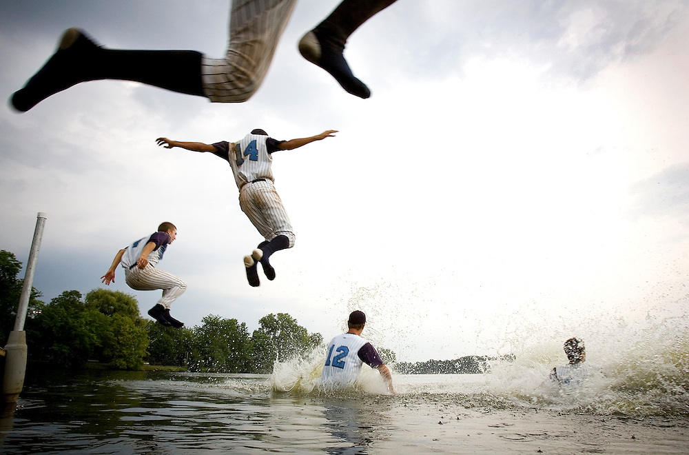 After winning the Wisconsin state baseball championship West Bend players jump into the Wisconsin River for a traditional chapmionship swim.
