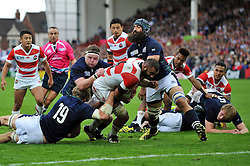 Michael Leitch of Japan looks to reach the try-line but is stopped just short - Mandatory byline: Patrick Khachfe/JMP - 07966 386802 - 23/09/2015 - RUGBY UNION - Kingsholm Stadium - Gloucester, England - Scotland v Japan - Rugby World Cup 2015 Pool B.