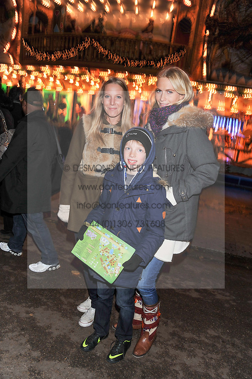 Left to right, ALICE NAYLOR-LEYLAND, POPPY DELEVINGNE and her dodson TARKA ENGLISH at the opening of the 2012 Winter Wonderland, Hyde Park on 22nd November 2012.