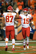 Kansas City Chiefs quarterback Patrick Mahomes (15) gets a high five from Kansas City Chiefs tight end Travis Kelce (87) after Mahomes runs for a 14 yard touchdown good for a 10-3 Chiefs lead in the second quarter during the NFL week 4 regular season football game against the Denver Broncos on Monday, Oct. 1, 2018 in Denver. The Chiefs won the game 27-23. (©Paul Anthony Spinelli)