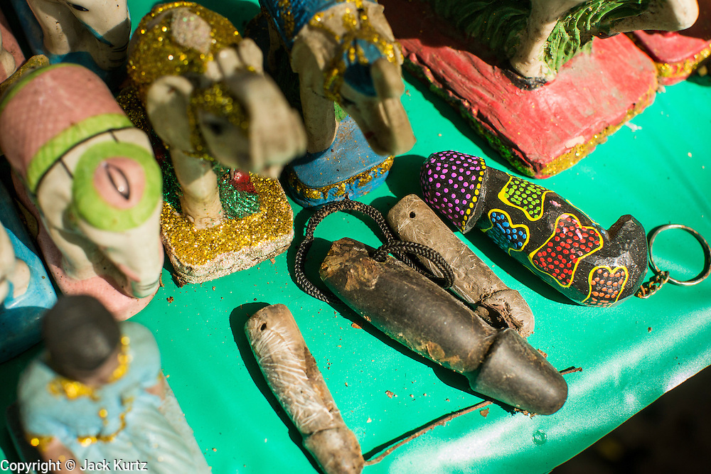 04 JANUARY 2012 - BANGKOK, THAILAND:  Small penis carvings that used to be keychains at the Lingam Shrine. The Lingam Shrine is a phallus garden behind the Swissotel Nai Lert Park Hotel, an exclusive 5 star hotel in Bangkok. Clusters of carved stone and wooden shafts surround a spirit house and shrine built by a Bangkok millionaire to honour Jao Mae Thap Thim, a female deity thought to reside in a banyan tree on the site. According to Bangkok legend, a woman who made an offering at the shrine had a baby after praying at the shrine, and it has received a steady stream of worshippers ever since.   PHOTO BY JACK KURTZ