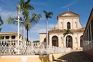 The Iglesia Parroquial de la Santisima Trinidad (Holy Trinity Church) in the<br /> cobblestoned Plaza Mayor, Trinidad, Cuba<br /> Trinidad is a World Heritage Site