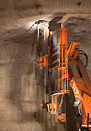 A roof bolting machine works on the ceiling of the mine at Pattison Sand Company in Garnavillo, Iowa on June 5, 2013.