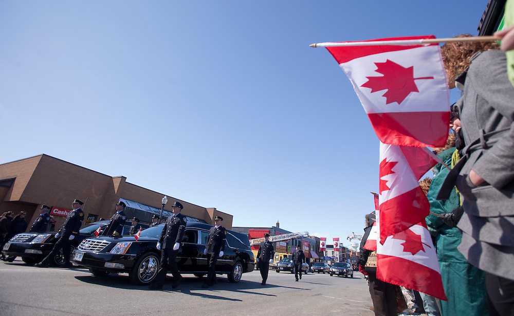 Fire fighters escort the hearses carrying their fallen colleagues Kenneth Rae and Raymond Walter during a funeral procession in Listowel Ontario, Thursday, March 24, 2011. The men were killed fighting a blaze in a dollar store last Thursday when the roof collapsed.<br /> THE CANADIAN PRESS/ Geoff Robins