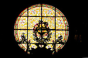 Stained glass window in cathedral, Bressanone, Italy.