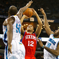 January 3, 2011; New Orleans, LA, USA; Philadelphia 76ers shooting guard Evan Turner (12) shoots over New Orleans Hornets defenders Emeka Okafor (50) and Quincy Pondexter (20) during the second quarter at the New Orleans Arena.   Mandatory Credit: Derick E. Hingle