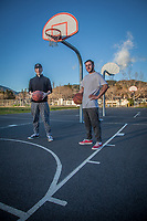 Cousins, Isaiah and Johnny Bueno, shoot hoops in the last light of the day near Calistoga High School.