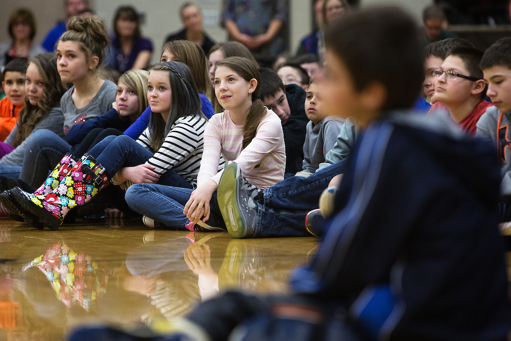 GABE GREEN/Press<br /> <br /> Adel Herrera, 12, watches guest speaker Stu Cabe attentively Tuesday during an anti-bullying assembly at Woodland Middle School. Cabe says he travels to schools around the country to teach kids two words, &ldquo;be nice.&rdquo;
