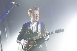 © Licensed to London News Pictures. 13/12/2013. London, UK.   Two Door Cinema Club performing live at The O2 Arena.  In this picture - Alex Trimble.Two Door Cinema Club are a Northern Irish indie rock band consisting of Alex Trimble (vocals, rhythm guitar, beats, synths) Sam Halliday (lead guitar, backing vocals), and Kevin Baird (bass, backing vocals). Photo credit : Richard Isaac/LNP