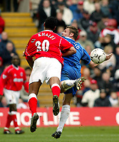 Photo. Chris Ratcliffe<br />Charlton v Birmingham. FA Premiership. 19/04/2003<br />Where did it go? Geoff Horsfield and Tahar El-Khalej tussle for the ball
