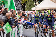 Movistar team members leave the signature check area of Il Lombardia 2015 Bergamo - Como