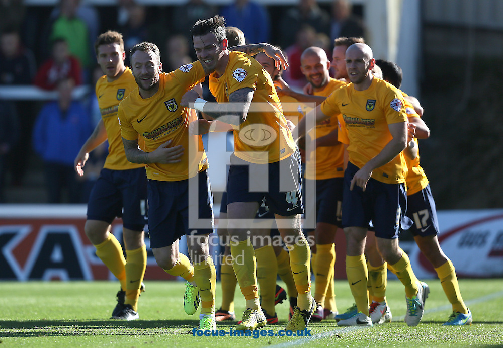 Picture by Paul Gaythorpe/Focus Images Ltd +447771 871632<br /> 28/09/2013<br /> Oxford United players celebrate Ryan Williams scoring the first goal against Hartlepool United during the Sky Bet League 2 match at Victoria Park, Hartlepool.