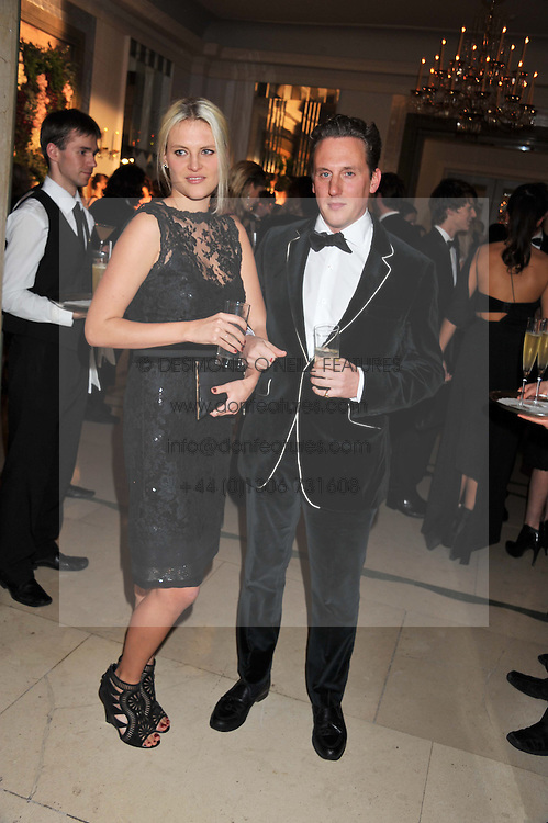 HARRY BECHER and OLIVIA PERCIVAL  at a dinner and dance hosted by Leon Max for the charity Too Many Women in support of Breakthrough Breast Cancer held at Claridges, Brook Street, London on 1st December 2011.