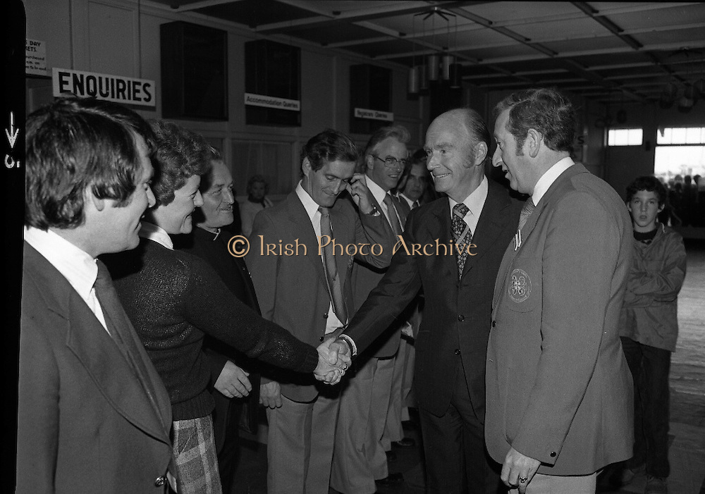 President Hillery at The Community Games..1979..15.09.1979..09.15.1979..15th September 1979..President Patrick Hillery attended the opening of The National Community Games finals at Mosney, Co Meath today. The finals were held in the grounds of The Butlins Holiday Centre and were sponsored by Tayto Irl Ltd,Greencastle Road,Coolock,Dublin..The president is pictured being introduced to some of the officials of the games without whose hard work the games would not take place.