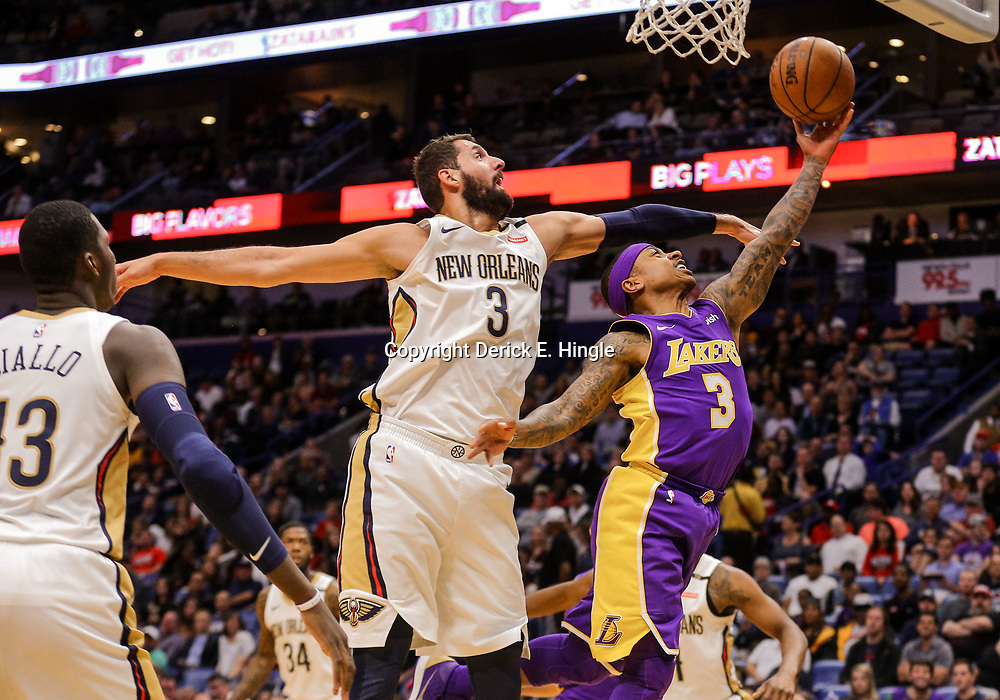 Mar 22, 2018; New Orleans, LA, USA; Los Angeles Lakers guard Isaiah Thomas (3) shoots over New Orleans Pelicans forward Nikola Mirotic (3) during the first quarter at the Smoothie King Center. Mandatory Credit: Derick E. Hingle-USA TODAY Sports