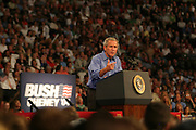 President George W. Bush makes a re-election campaign stop at the Xcel Energy Center on Aug. 18, 2004, in St. Paul, MN. (Charles Hall/challphotos.com)