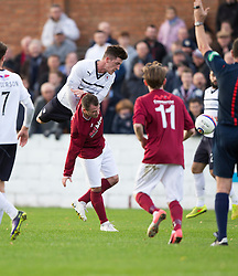 Raith Rovers Ross Perry over Linlithgow Rose Colin Strickland.<br /> Half time : Linlithgow Rose 0 v 0 Raith Rovers, William Hill Scottish Cup Third Round game player today at Prestonfield.