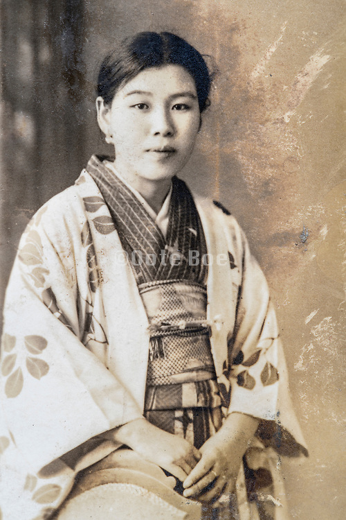 young adult woman in traditional kimono clothing studio portrait ca 1930s Japan