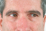 close up of a middle aged man's face with his eyes looking to the right