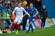 Portsmouth midfielder Ronan Curtis (11) and Gillingham FC defender Barry Fuller (12)  during the EFL Sky Bet League 1 match between Gillingham and Portsmouth at the MEMS Priestfield Stadium, Gillingham, England on 26 December 2018.