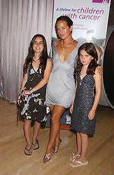 JADE JAGGER with her daughters ASSISI and AMBA at party in aid of cancer charity Clic Sargent held at the Sanderson Hotel, Berners Street, London on 4th July 2005.<br />