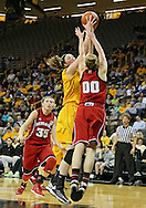 February 11 2013: Iowa Hawkeyes center Morgan Johnson (12) tries to put up a shot over Nebraska Cornhuskers guard Lindsey Moore (00) during the first half of the NCAA women's basketball game between the Nebraska Cornhuskers and the Iowa Hawkeyes at Carver-Hawkeye Arena in Iowa City, Iowa on Monday, February 11 2013.