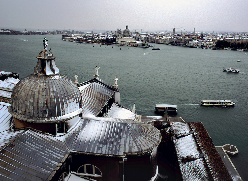 Venice under snow seen from the campanile of the Palladian church of San Giorgio Maggiore.  View across to the mouth of the Grand Canal...