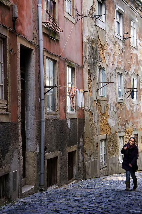A girl in the old streets of the Alfama in Lisbon