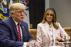 U.S. First Lady Melania Trump listens as President Donald Trump speaks during an opioid round table at the White House in Washington, DC, USA, 12 June 2019. Photo by Zach Gibson/Pool/ABACAPRESS.COM