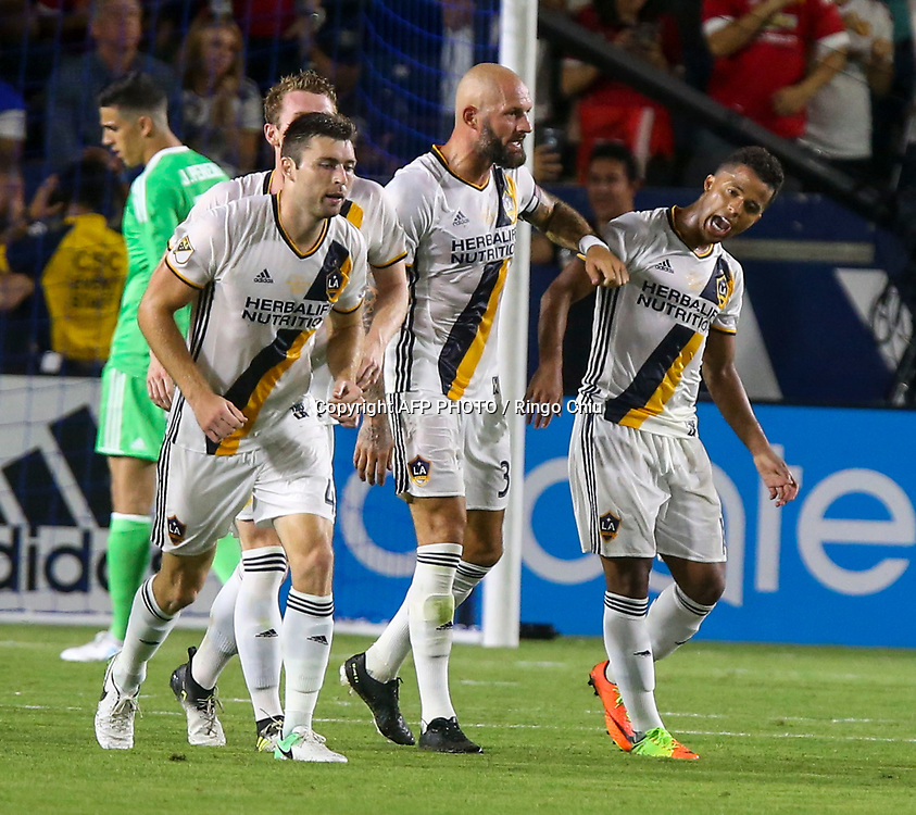 Los Angeles Galaxy celebrates a gaol against Manchester United during the second half of a national friendly soccer game at StubHub Center on July 15, 2017 in Carson, California. Manchester United won 5-2. AFP PHOTO / Ringo Chiu