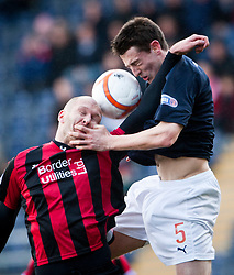 Queen of the South's Sam Parkin and Falkirk's Murray Wallace..Falkirk 3 v 0 Queen of the South, 25/2/2012..© Michael Schofield.