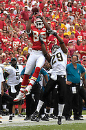 October 7, 2007 - Kansas City, MO..Wide receiver Dwayne Bowe #82 of the Kansas City Chiefs goes up for a pass against pressure from defensive back Brian Williams #29 of the Jacksonville Jaguars in the second half, during a NFL game at Arrowhead Stadium in Kansas City, Missouri on October 7, 2007...MLB:  The Jaguars defeated the Chiefs 17-7.  .Photo by Peter G. Aiken/Cal Sport Media