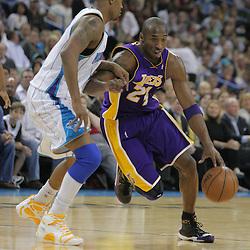 12 November 2008:  Los Angeles Lakers guard Kobe Bryant (24) drives past New Orleans Hornets guard Morris Peterson (9) during a NBA regular season game between the Los Angeles Lakers and the New Orleans Hornets at at the New Orleans Arena in New Orleans, LA..