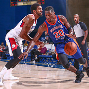 Westchester Knicks Forward NIGEL HAYES (20) drives pass defender Delaware 87ers Forward JAMES MICHAEL MCADOO (14) in the second half of a NBA G-league regular season basketball game between the Delaware 87ers and the Westchester Knicks (New York Knicks) Tuesday, Nov. 07, 2017, at The Bob Carpenter Sports Convocation Center in Newark, DEL