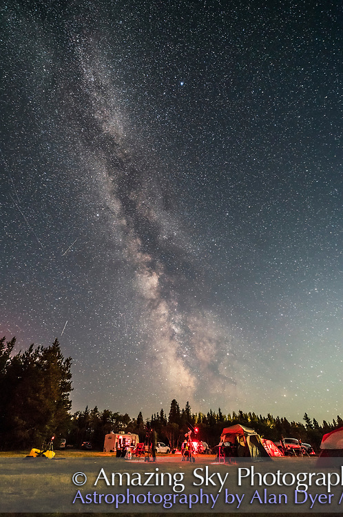 A scene at the 2017 Saskatchewan Summer Star Party, on a rare evening with the waxing Moon lighting the foreground, due to the timing on the weekend after the total eclipse. However, the Milky Way was still prominent to the south over the observing field in the Cypress Hills of southwest Saskatchewan. <br /> <br /> Vega is at top. The bright sky at bottom right is from the Moon off frame at right. <br /> <br /> This is a single exposure with the 14mm Rokinon lens at f/2.5 for 30 seconds with the Canon 6D MkII at ISO 3200.