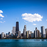 Downtown city skyline of Chicago lakefront buidlings along Lake Michigan. Includes the John Hancock Center Building which is a famous part of the Chicago skyline and is one of the tallest skyscrapers in the world.