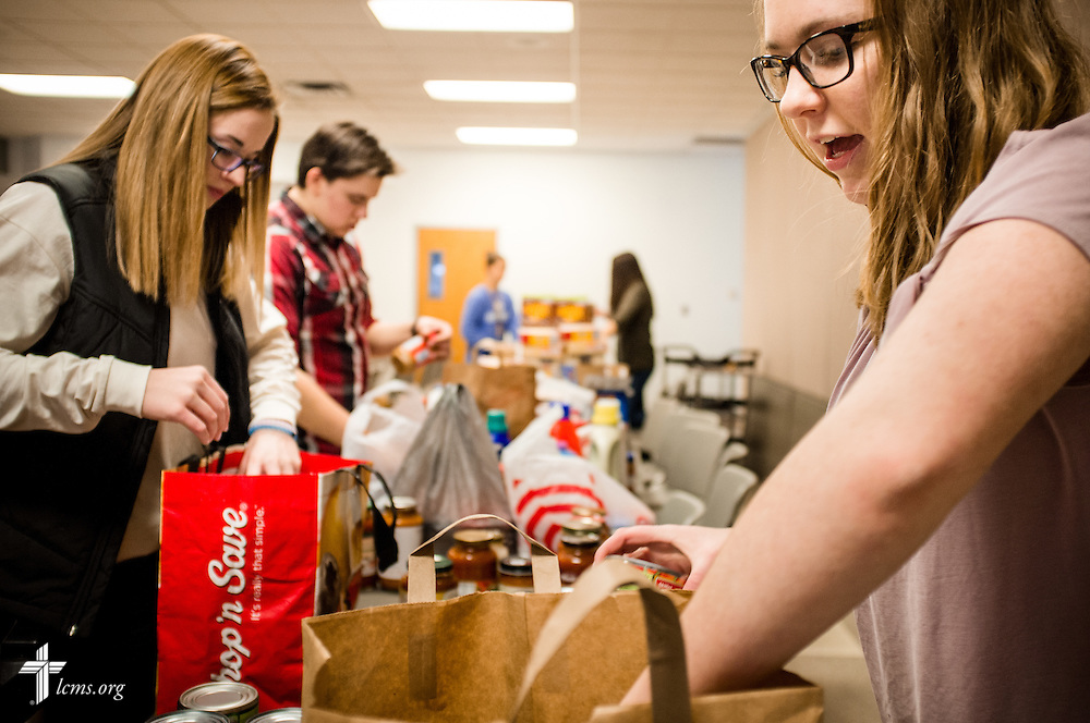 Isabella Schneider (right) and Sarah Franklin help pack food pantry items for delivery on Sunday, Feb. 26, 2017, at Immanuel Lutheran Church & School in St. Charles, Mo. LCMS Communications/Erik M. Lunsford