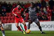 John Akinde of Lincoln City tackles Michael Doughty of Swindon Town during the EFL Sky Bet League 2 match between Swindon Town and Lincoln City at the County Ground, Swindon, England on 12 January 2019.