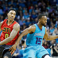 01 November 2015: Charlotte Hornets guard Kemba Walker (15) drives past Atlanta Hawks guard Jeff Teague (0) during the Atlanta Hawks 94-92 victory over the Charlotte Hornets, at the Time Warner Cable Arena, in Charlotte, North Carolina, USA.