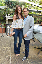 ARUN NAYAR and KIM JOHNSON at a party to celebrate 'A Year In The Garden' celebrating the first year of The Ivy Chelsea Garden, 197 King's Road, London on 16th May 2016.