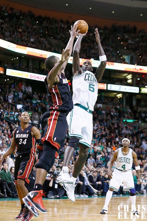 27 January 2013: Boston Celtics power forward Kevin Garnett (5) takes a jumpshot over Miami Heat center Chris Bosh (1) during the Boston Celtics 100-98  2OT victory over the Miami Heat at the TD Garden, Boston, Massachusetts, USA.