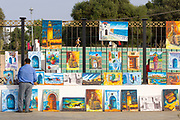 Asilah street art seller exhibits artwork during the International Cultural Festival, Asilah, Northern Morocco, 2015-08-10. <br />