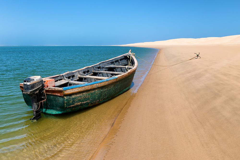 Fishing boat at the beach of Lagoon Khenifiss (Lac Naila), Atlantic coast, Morocco.